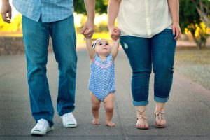 Mom and dad holding baby's hands | Get Your Husband to Step up in Parenting and Housework | muchnessmama.com | Parenting is a team sport