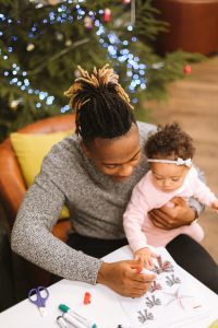 Black man coloring with his young daughter | Get Your Husband to Step up in Parenting and Housework | muchnessmama.com