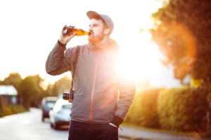 Man standing in street drinking a beer from a bottle | The mentally Ill or Addict uses their problems as an excuse for their abuse | muchnessmama.com